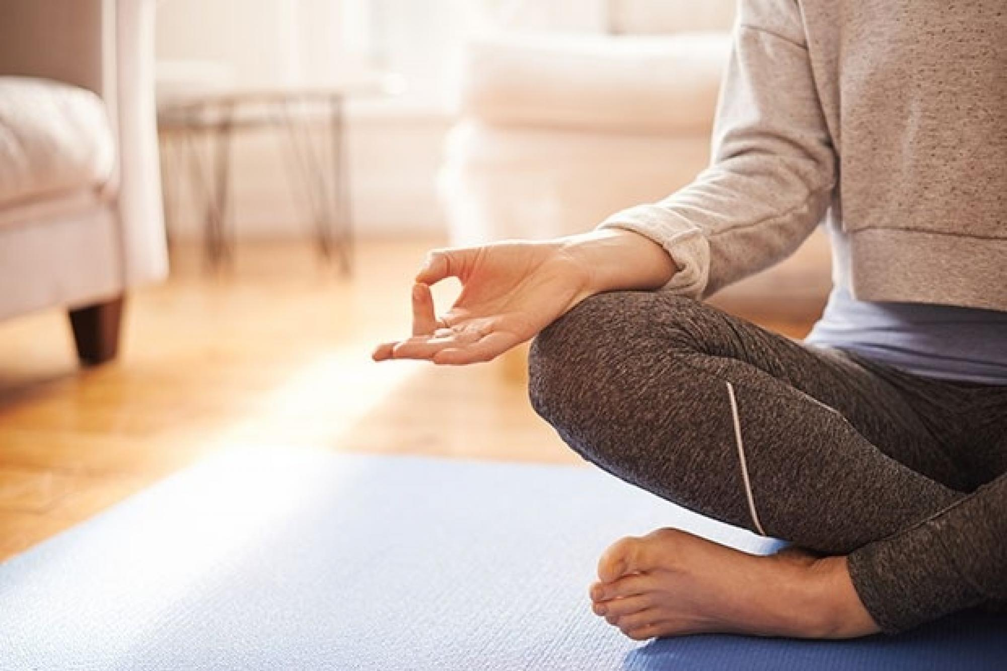 Woman meditating Getty Images 957709278 67ae765